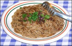 Spaghetti puttanesca-style with olive pesto